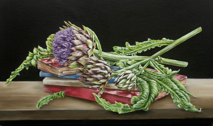 painting of artichoke on top of a book resting on a counter top