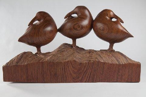 sculpture of three dunlin sandpipers